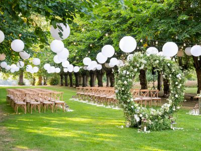Beautiful outdoor wedding ceremony set up in the Lime Grove at Coworth Park
